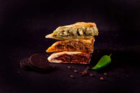 Trio stuffed naan, green tikka chicken, qeema minced meat and chocolate brownie cookie stacked.
