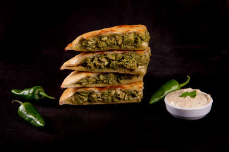 Green tikka stuffed naan with green chillies with garlic mayo dipper