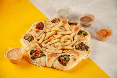 Philly cheese steak stuffed naan desi pizza cooked in wood fired oven, food fusion. 写真素材