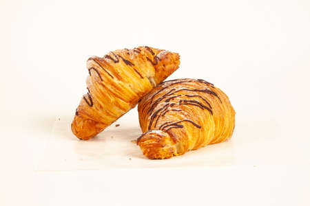 Chocolate filled brioche croissant flaky made in butter isolated on white background