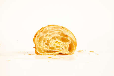 Brioche plain flaky butter croissant crisp and golden in color isolated on white background 写真素材