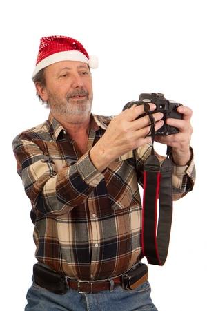 P�re No�l avec appareil photo professionnel
