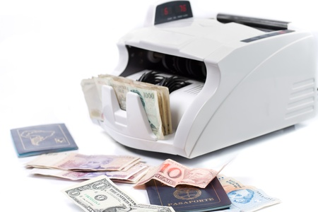 An electronic money counter processing bills and passport