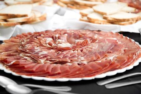 slice of dry cured ham - Jamon Crudo Stock Photo