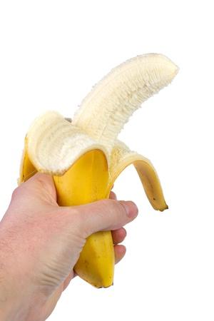 Banane m�re dans la main isol� sur fond blanc