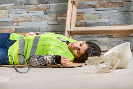 accident at work: Woman in accident at workplace Stock Photo