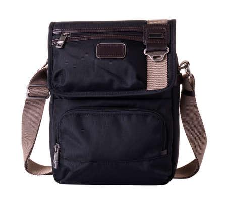 Black textile messenger bag for men. Wide shoulder strap in beige color. On a white background Imagens