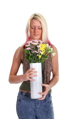 Una mujer oliendo flores Foto de archivo - 9554937