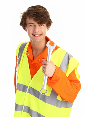 boiler suit: A workman wearing a boiler suit, hiviz vest and holding a spanner Stock Photo