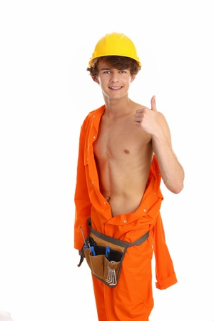 boiler suit: A workman giving a thumbs up sign, that has partly removed his boiler suit standing upright Stock Photo