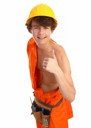 workman with a thumbs up that has partly removed his boiler suit Stock Photo - 10051639