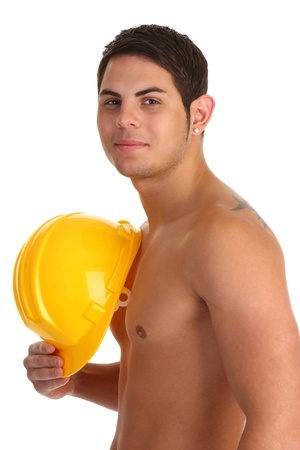 no shirt: Workman with no shirt and holding his yellow hard hat