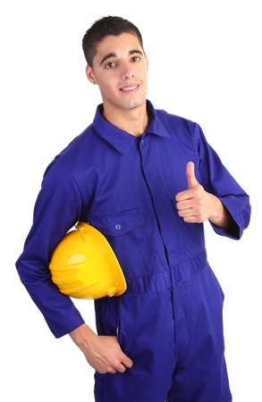 A guy wearing overals and holding a hardhat with a thumbs up sign. photo