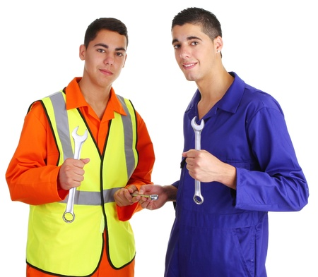 Two workmen with spanners smiling
