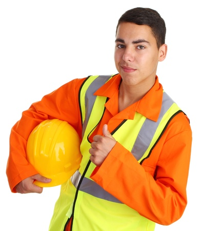 A workman with a thumbs up sign holding his hard hat