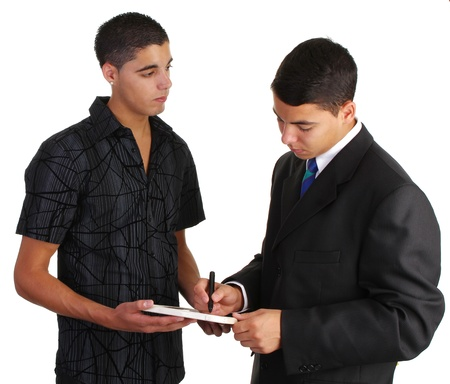 Two guys looking at a sign with one of them writing on it Stock Photo - 10695299