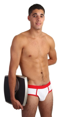 man in underwear: A guy in his underwear with a pair of scales Stock Photo