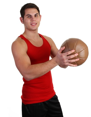 A guy with a medicene ball in a red vest photo
