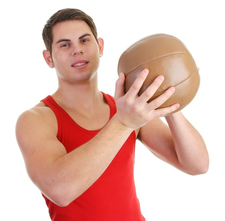 A guy with a medicene ball in a red top photo