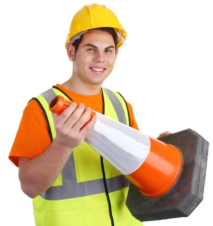 A guy holding a road cone smiling. photo