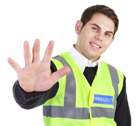 A security guard holding his hand out.