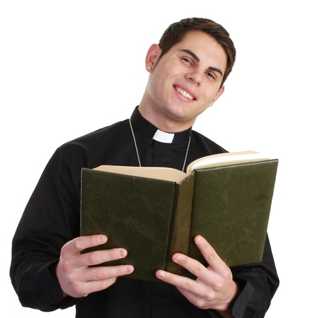 A priest with a bible photo