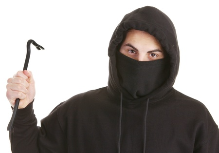 A robber dressed in black with a crowbar