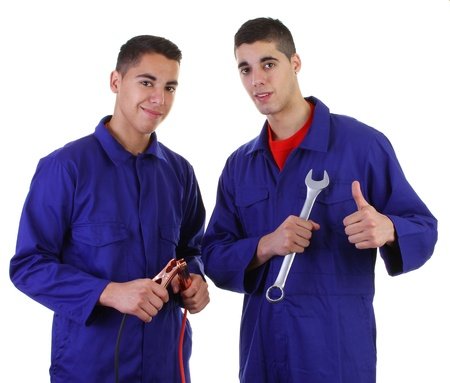Two mechanics with jump leads and a spanner Stock Photo - 11324067