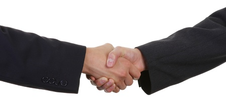 two guys shaking hands wearing suits Stock Photo