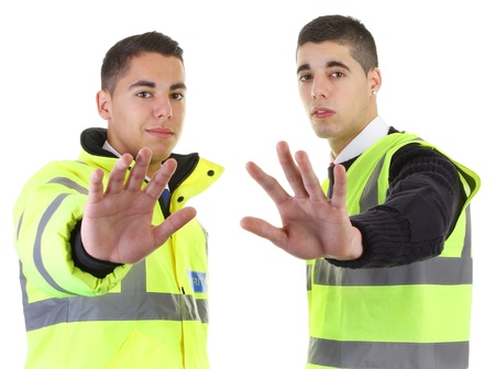 Two security guards with their hands out Stock Photo