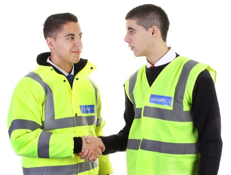 Two security guards greeting each other with a handshake photo