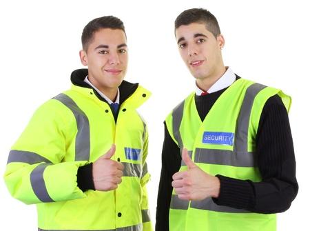 guarda de seguridad: Dos guardias de seguridad con un pulgar hacia arriba