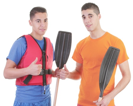 Two friends holding oars and one wearing a life jacket photo