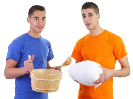 Guys holding sauna tools and a white towel photo