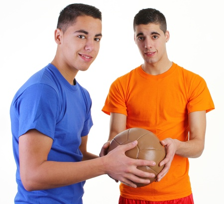 Two guys with a medicene ball holding it together photo