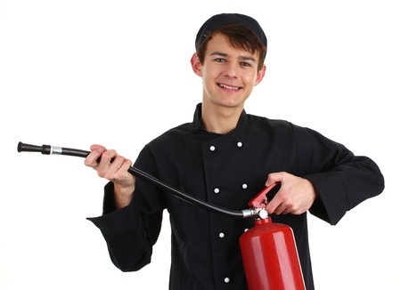 A chef with a fire extinguisher, isolated on white Stock Photo