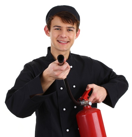 A chef with a fire extinguisher isolated on white. photo