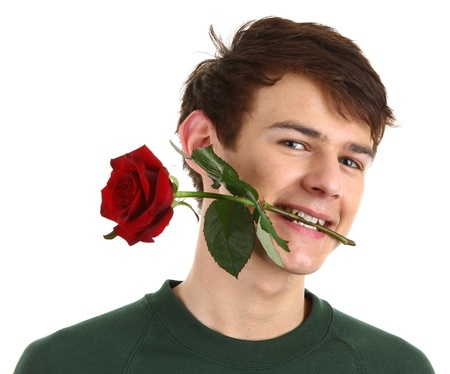 A guy holding a red rose in his mouth