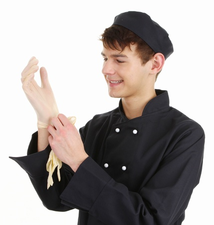 hygeine: A chef putting on gloves to prepare food
