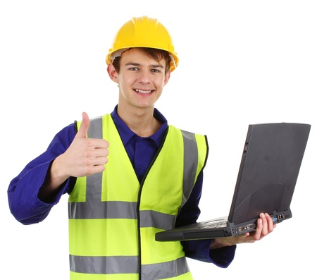 A engineer holding a laptop with a thumbs up sign isolated on white. photo