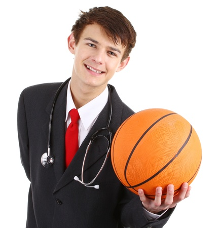 A doctor smiling holding a basketball, isolated on white photo