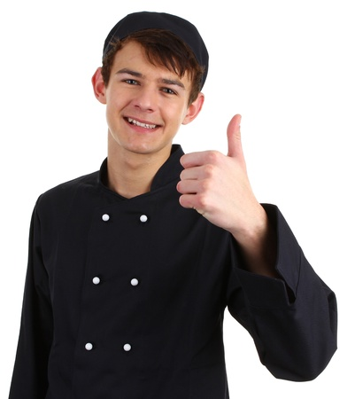 chef uniform: A chef with a thumbs up sign isolated on white