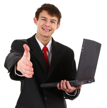 A business guy with a laptop offering a handshake, isolated on white Stock Photo - 12016820