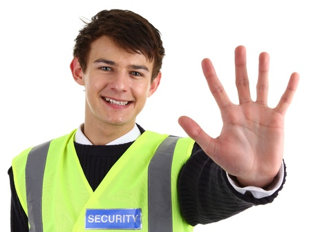 A security guard holding out his hand, isolated on white Stock Photo - 12048921