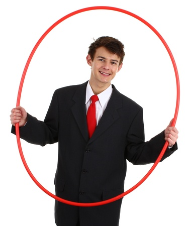 A business guy holding a hoop about to go through it, isolated on white photo