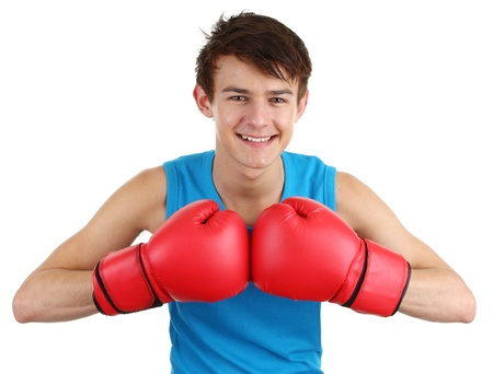 A boxer with his gloves together, isolated on white