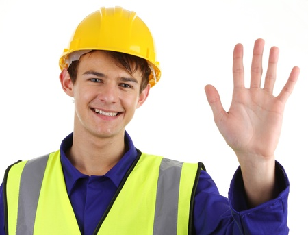 A happy construction worker waving or with halt or stop sign photo