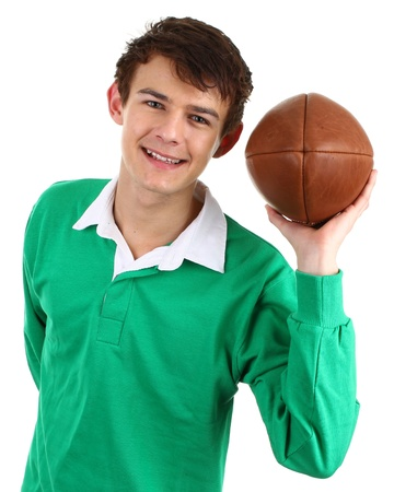 A rugby player holding a ball, isolated on white Stock Photo