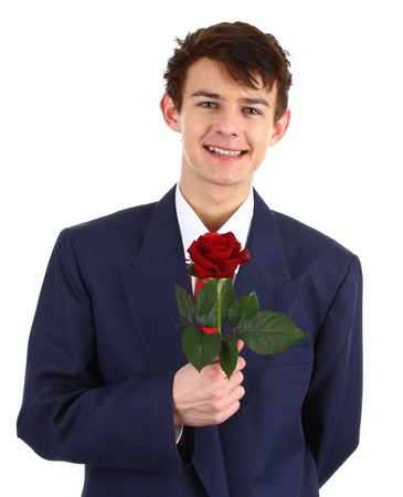 A guy with a red rose, isolated on white photo