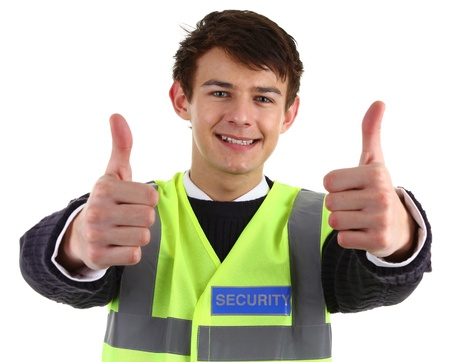 A security guard with a thumbs up sign, isolated on white Stock Photo - 12504251